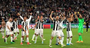 Juventus celebrate reaching the Champions League final after their 4-1 aggregate win over AS Monaco. Photograph: Richard Heathcote/Getty