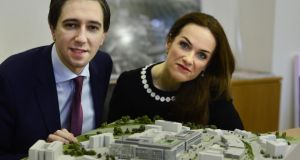 Minister for Health Simon Harris and National Maternity Hospital (NMH) master Rhona Mahony with a model of the proposed new NMH at St Vincent's hospital in Dublin. Photograph: Cyril Byrne