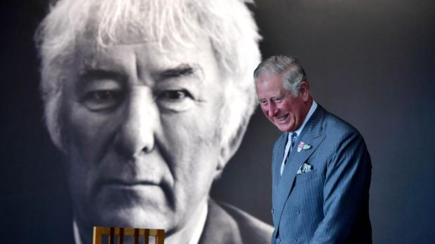 Prince Charles smiles as he walks past a portrait of the late Seamus Heaney in Bellaghy. Photograph: Charles McQuillan/Getty Images