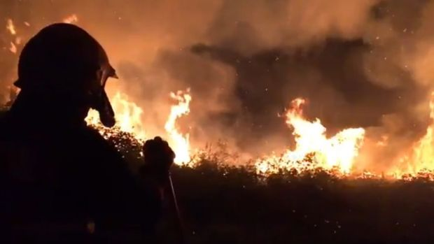 Bantry Fire Brigade crew dealing with gorse fire near Aughaville on Tuesday
