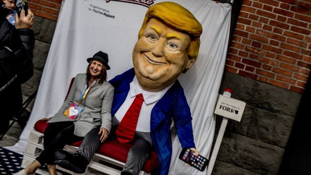 A visitor poses for a photo with an effigy of US president Donald Trump during Re:publica in Berlin in May. Photograph: Filip Singer/EPA