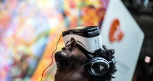 A visitor uses a 2DF headset at Re:publica in Berlin in May. Photograph: Filip Singer/EPA