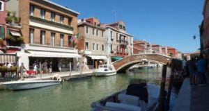 The four-bedroom Italian maisonette is a few steps from the first boat stop to Venice island