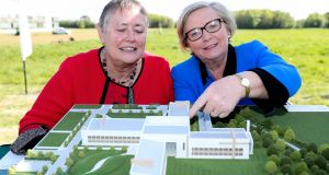 Dr Sheila Willis, director general of Forensic Science Ireland, and  Minister for Justice  Frances Fitzgerald, who  turned the sod to  mark the start of construction of a new €60 million laboratory   in Celbridge, Co Kildare. Photograph:  Maxwell Photography