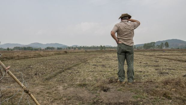 Mark Whiteside of the Mines Advisory Group (MAG) oversees the clearing of a rice field for a local farmer in Phonsavan, northeast Laos. Photograph: Brenda Fitzsimons