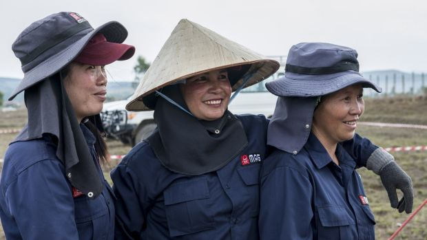 Staff from Mines Advisory Group (MAG) at the end of a long day demining a rice field in Phonsavan, northeast Laos. Photograph: Brenda Fitzsimons