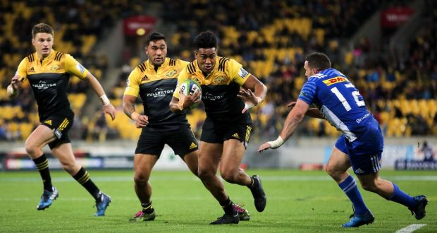 Of New Zealand S Wellington Hurricanes Beats The Defence To Score A Try Against South Africa