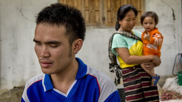 Khammeung Phommalein, aged 25, at his home in the Kham district of Phonsavan, Laos. Khammeung was blinded by a UXO when he brought it home and it exploded. Photograph: Brenda Fitzsimons