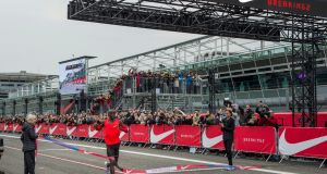 Eliud Kipchoge  clocking a time of 2:00.24 in a marathon event in Monza, north of Milan. Kipchoge was attempting to become the first athlete to run under two hours and missed his goal by just 25 seconds. Photograph: EPA/Nike