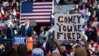 "A supporters holds up a ""Comey You're Fired"" sign back in early November, when then Republican presidential candidate Donald Trump was speaking in Raleigh, North Carolina. Photograph: Jabin Botsford/The Washington Post via Getty Images"