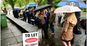 A large crowd queues outside  an apartment block on Northumberland Road ahead of a viewing. Photograph: Bryan O'Brien