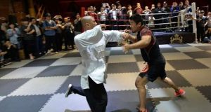 Tai chi master Wei Lei (41) was floored in 10 seconds by 38-year-old MMA coach Xu Xiaodong.