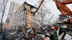 An excavator demolishes a five-storey apartment block in Moscow. City authorities have initiated a plan to demolish low-rise housing. Photograph: Natalia Kolesnikova/AFP/Getty Images