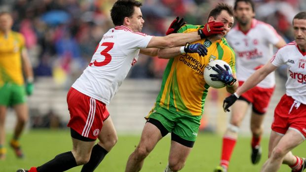 Tyrone's Ryan McMenamin and Karl Lacey of Donegal during the Ulster semi-final in 2012. Photo: Cathal Noonan/Inpho