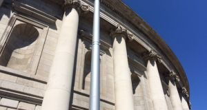 Plonking tall, thick poles in front of the curved eastern colonnade of the Old Parliament or anywhere else on the Luas Cross City line route is much more visually obtrusive than attaching wires directly to buildings
