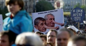Demonstrators hold placards during a protest rally against Czech finance minister Andrej Babis and President Milos Zeman in Prague on Wednesday. Photograph: David W Cerny/Reuters
