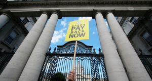 A garda demands pay restoration during a protest  outside Government Buildings, Dublin. File photograph: Nick Bradshaw