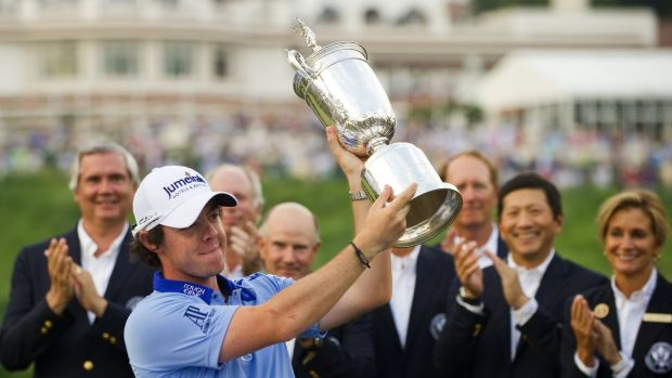 McIlroy holds aloft the US Open trophy after winning at Congressional in 2011. Photo: Getty Images