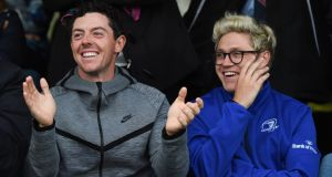 Rory McIlroy attends an Ulster v Leinster rugby match with Niall Horan – one of the many interests he has away from the course. Photo: Getty Images