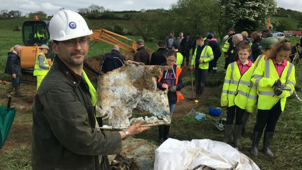 Aviation historian Jonny McNee with what remains of the cockpit door of a second World War Spitfire aircraft at the dig site at Figullar, Emyvale, Co Monaghan. Photograph: Dara Mac Dónaill/The Irish Times