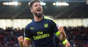 Arsenal's Olivier Giroud celebrates after scoring his second and his side's fourth goal in the Premier League game against Stoke City. Photograph:  Rui Vieira/EPA