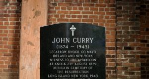 A new headstone for the grave of John Curry, an Irish immigrant laborer who died in 1943,  reburied at the Basilica of St. Patrick's Old Cathedral in Little Italy, in New York on Saturday. Photograph: Karsten Moran/The New York Times