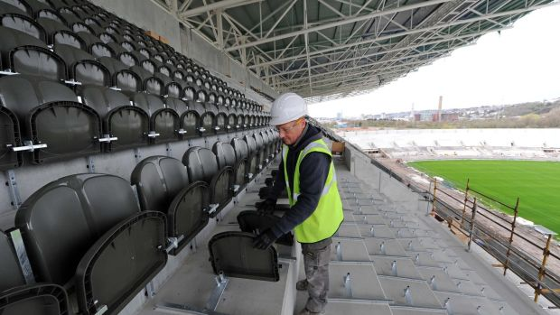 Darren Wright of Link Seating working on installing the new spectator seating in the south stand during the Pairc Uí Chaoimh redevelopment. Picture: Denis Minihane