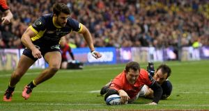Alex Goode of Saracens dives to score his team's third try during the European Rugby Champions Cup Final between ASM Clermont Auvergne and Saracens at Murrayfield Stadium. Photo: Stu Forster/Getty Images