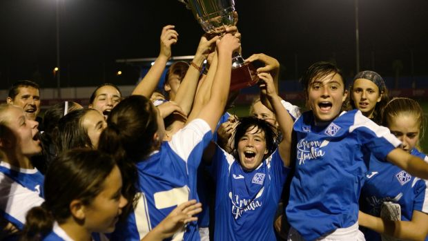 Members of AEM Lleida, a girls amateur soccer team, celebrate a 3-2 victory and their league championship in Lleida, Spain, on April 25th, 2017. Photograph: Samuel Aranda/The New York Times