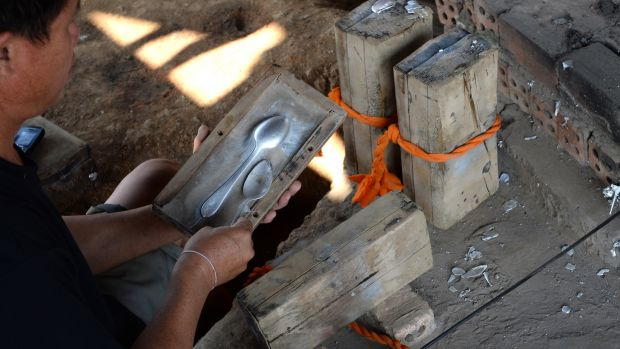 Kien Pheng making spoons from recycled explosives at Ban Napia in Laos. Photograph: Brenda Fitzsimons / The Irish Times