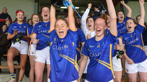 Tipperary captain Samantha Lambert lifts the cup after the Lidl Ladies National Football League Division 3 final replay against Wexford. Photograph: Matt Browne/Sportsfile