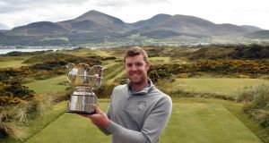 Peter O'Keefe with the Flogas Irish Amateur Open trophy.
