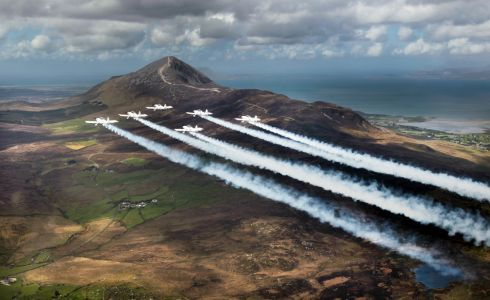 AIR DISPLAY: Team Raven, formation aerobatic display team from the UK, flying RV-8 aerobatic aircraft, fly past Croagh Patrick during Westport Air Show. Photograph: Frank Grealish.