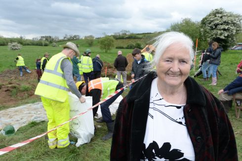 ARCHAEOLOGICL DIG: Josie McCusker, who was five years old when a Spitfire crashlanded beside her home, at the site in Emyvale, Co Monaghan. Photograph: Dara Mac Donaill