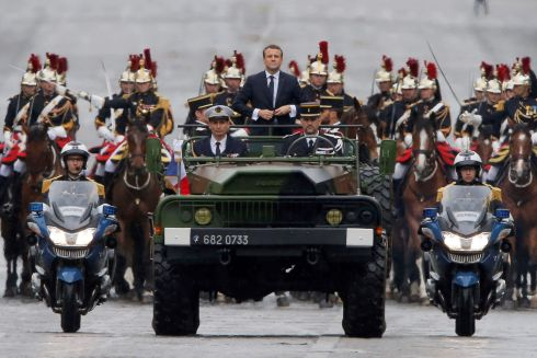 MACRON'S MOMENT: Newly elected French president Emmanuel Macron parades in a military car on the Champs Elysees  after his formal inauguration ceremony. Photograph: AFP/Getty Images