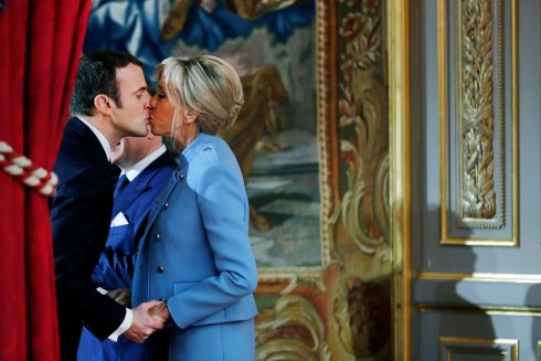 INTIMATE MOMENT: French president Emmanuel Macron kisses his wife Brigitte Trogneux during the handover ceremony in Paris. Photograph: Reuters