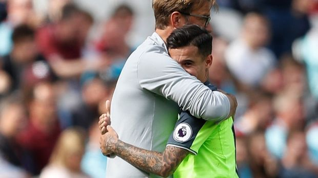 Liverpool manager Jürgen Klopp embraces his star player Philippe Coutinho. This hug felt a little different: tighter, longer, stronger. A thank-you in physical form and perhaps even the warmest of pleas to the Brazilian to stay. Photograph: Peter Nicholls/Reuters