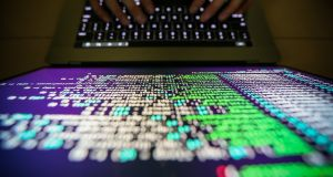 A programer shows a sample of decrypting source code in Taipei, Taiwan over the weekend. A'WannaCry' ransomware cyber attack has hits thousands of computers in 99 countries. Photograph: EPA
