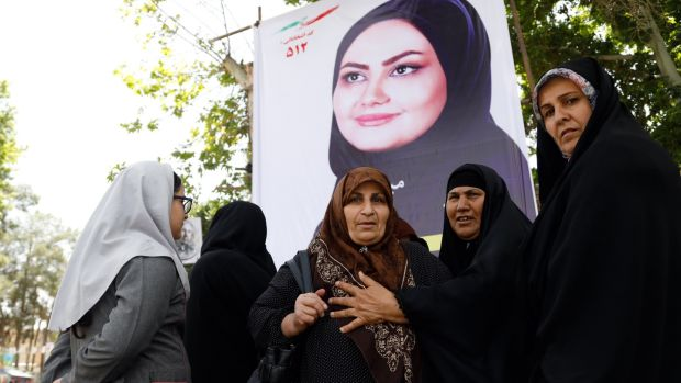Iranian women at an election banner of Shaghayegh Mirzayi who is standing in municipal elections in the city of Varamin. The municipal elections which will be held at the same time as the presidential election – May 19th, 2017. Photograph: Abedin Taherkenareh/EPA