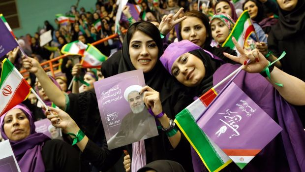 Supporters of Iranian president Hassan Rouhani: he and five other candidates are running in presidential elections in a country where millions run moneymaking schemes just to keep up and youth unemployment is at 30 per cent. Photograph: Abedin Taherkenareh/EPA