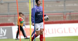 Munster's Tyler Bleyendaal will train with the team this week. Photograph: Billy Stickland/Inpho