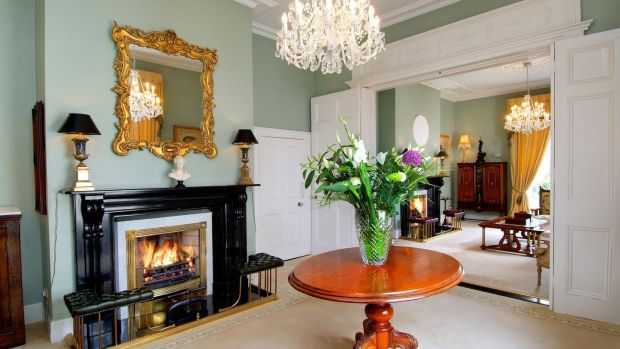 The interconnecting drawing and diningrooms on the upper floor have very impressive ceiling roses and original fireplaces