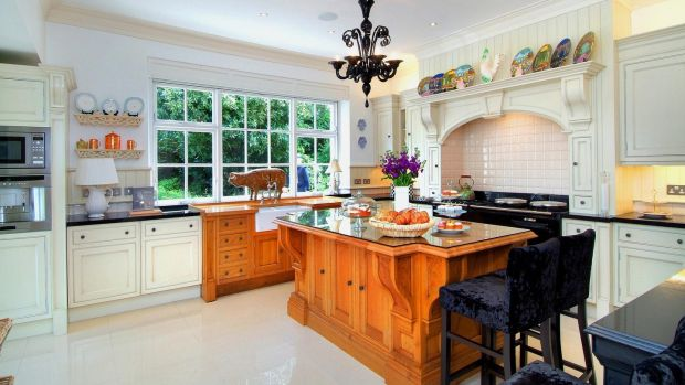 The second Clive Christian kitchen at Landore Hall, with a solid oak island, and large wooden pig over the sink
