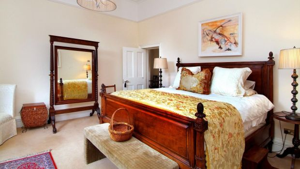 The opulent master bedroom at Landore Hall has Clive Christian fitted wardrobes