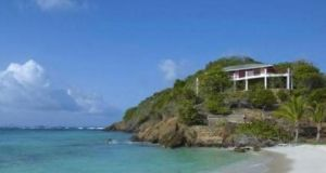 This two-bedroom, two-bathroom house sits 25ft above a swimming beach replete with white sand and coral reefs.