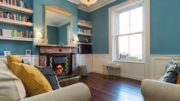 The drawing room at 3 Oxford Road has new wainscoting and a period fireplace