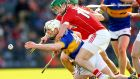 Cork's Seamus Harnedy tackles Michael Cahill of Tipperary. Photograph: INPHO/Cathal Noonan