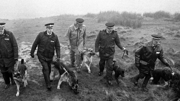 Police use specially trained sniffer dogs on Saddleworth Moor, near Oldham, in 1986, to search for Keith Bennett, one of the victims of moors murderer Ian Brady. Photograph: PA Wire