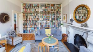 The living room to the rear of 54 Kenilworth Square in Rathgar basks in southerly light and features a wall of tightly packed bookshelves with a hanging library ladder.