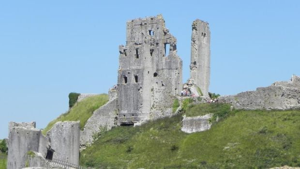 In 'Five on a Treasure Island', Enid Blyton set Corfe Castle on the imaginary Kirrin Island but changed nothing of the edifice itself.